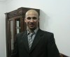 Mohamad Qwaider personal photo wearing a black suit