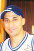 Mohamad Qwaider personal photo in a blue cap