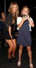 Kim kardashian picture as Leaving Katsuya restaurant after having dinner on August 27th 2009 standing with a young fan