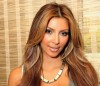 Kim kardashian picture from August 2009 photoshoot of her new high lighted hair style in face closeup