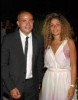 Amr Diab photo with his wife zaina wearing a formal suit and dress