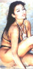 Haifa Wehbe old picture before becoming a singer and before plastic surgery wearing a black bikini on the beach