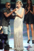 Kayne West onstage withTaylor Swift after she won the Best Female Video award at the 2009 MTV Video Music Awards at Radio City Music Hall on September 13, 2009 in New York City