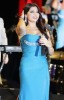 Haifa Wahbi picture during a concert wearing a glam baby blue dress singing on stage