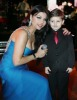 Haifa Wahbi picture during a concert wearing a glam baby blue dress with a boy fan