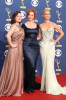 Elisabeth Moss with Christina Hendricks and January Jones arrive at the 61st Primetime Emmy Awards