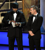 LL Cool J and Chris ODonnell onstage presenting the Outstanding Supporting Actress In A Drama Series award during the 61st Primetime Emmy Awards