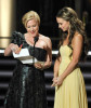 Patricia Arquette and Jennifer Love Hewitt present the Outstanding Writing for a Miniseries or Movie award at the 61st Emmy Awards