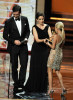 Tina Fey and actor Jon Hamm present the Outstanding Supporting Actress in a Comedy Series award  to actress Kristin Chenoweth during the 61st Primetime Emmy Awards