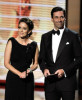 Tina Fey and actor Jon Hamm present the Outstanding Supporting Actress in a Comedy Series award onstage during the 61st Primetime Emmy Awards