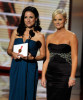 Amy Poehler and Julia Louis Dreyfus present the Outstanding Supporting Actor in a Comedy Series award onstage during the 61st Primetime Emmy Awards