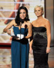 Amy Poehler and Julia Louis Dreyfus present the Outstanding Supporting Actor in a Comedy Series award onstage during the 61st Primetime Emmy Awards 5