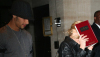 Jesus Luz picture with his girlfriend Madonna as she hides her face with a copy of the book Zohar to avoid the flashes of paparazzis cameras on september 22nd 2009 in New York 2