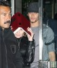 picture of Jesus Luz and Madonna as she hides her face with a copy of the book Zohar to avoid the flashes of paparazzis cameras on september 22nd 2009 in New York