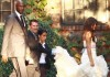 Khloe Kardashian wedding picture with her groom Lamar Odom walking behind her