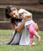 Alessandra Ambrosio picture as she is playing with her baby daughter Anja at the park