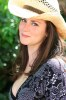 Katie Featherston photo wearing a cowboy hat