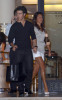 photo of Kevin Jonas with his fiance Danielle Deleasa walking together hand in hand 2