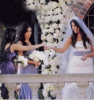 Khloe Kardashian with her bridesmaids sisters Kim and Kourtney during her  wedding