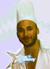 Mohamad Qwaider picture while cooking beef and french fries during a magazine interview in Ramadan 2009 5