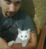 Mohamad Qwaider personal photo with his white small pet cat at his house 2