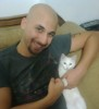 Mohamad Qwaider personal photo with his white small pet cat at his house 4