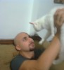Mohamad Qwaider personal photo with his white small pet cat at his house 3