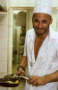 Mohamad Qwaider picture while cooking beef and french fries during a magazine interview in Ramadan 2009 3