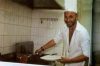 Mohamad Qwaider picture while cooking beef and french fries during a magazine interview in Ramadan 2009 2