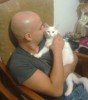 Mohamad Qwaider personal photo with his white small pet cat at his house 1