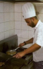 Mohamad Qwaider picture while cooking beef and french fries during a magazine interview in Ramadan 2009 1