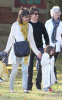 Tom Cruise and Katie Holmes with their daughter Suri at a park in Cambridge Massachusetts on October 10th 2009 10