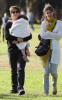 Tom Cruise and Katie Holmes with their daughter Suri at a park in Cambridge Massachusetts on October 10th 2009 11
