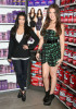 Khloe and Kim Kardashian introduce QuickTrim at the GNC store at the Beverly Center on October 15th 2009 in West Hollywood California 6