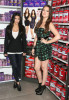 Khloe and Kim Kardashian introduce QuickTrim at the GNC store at the Beverly Center on October 15th 2009 in West Hollywood California 10