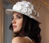 Tuba Buyukustun modeling studio photo shoots wearing a wedding dress 2