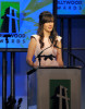 Zooey Deschanel presents the Breakthrough Screenwriter award onstage during the 13th annual Hollywood Awards Gala Ceremony held at The Beverly Hilton Hotel on October 26th 2009 2