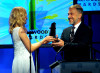Diane Kruger presents the Supporting Actor award onstage during the 13th annual Hollywood Awards Gala Ceremony held at The Beverly Hilton Hotel on October 26th 2009 2