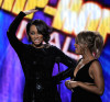 Keri Hilson and Toni Braxton speak onstage at the 2009 American Music Awards at Nokia Theatre LA Live on November 22nd 2009 in Los Angeles California 2