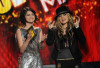 Orianthi and Selena Gomez onstage at the 2009 American Music Awards at Nokia Theatre LA Live on November 22nd 2009 in California 3