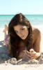 Ashley Greene photo shoot for the 2010 Sports Illustrated Swimsuit issue of January 2010 wearing a pink painted swim suit 1