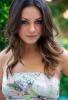 Mila Kunis wearing a spring floral dress