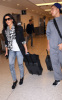 Kim Kardashian and her brother Rob spotted on January 14th 2010 at the Miami FL airport 2