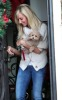 Ashley Tisdale picture as she stops by Coffee Bean and Tea Leaf with her cute puppy on December 13th 2009 around Beverly Hills 3