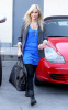 Ashley Tisdale walking around LA Studios in Hollywood on January 12th 2010 wearing black leggings and a blue top 2