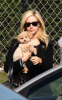 Ashley Tisdale seen getting coffee from Coffee Bean on January 15th 2010 in Toluca Lake with her little puppy 3
