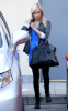 Ashley Tisdale walking around LA Studios in Hollywood on January 12th 2010 wearing black leggings and a blue top 1