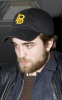 Robert Pattinson spotted growing a beard on January 22nd 2010 while arriving at his hotel in London 6