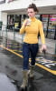 Britney Spears spotted heading to Starbucks in Calabasas California on January 26th 2010 wearing a yellow high neck top 6