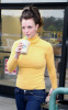 Britney Spears spotted heading to Starbucks in Calabasas California on January 26th 2010 wearing a yellow high neck top 4